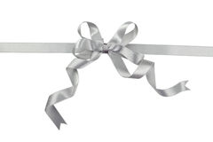 Silver bow on white background, close up Stock Images