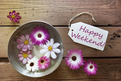 Silver Bowl With Cosmea Blossoms With Text Happy Weekend. Silver Bowl With Label With English Text Happy Weekend With Purple And White Cosmea Blossoms On Wooden stock images