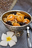 Silver bowl with dried fruits and nuts dessert Stock Images
