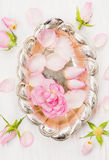 Silver bowl with water and roses Stock Image
