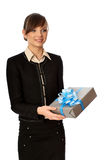 Silver box with blue bow as a gift. Woman holding a silver box with blue bow as a present Stock Images