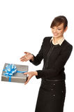 Silver box with blue bow as a present. Woman giving a silver box with blue bow as a gift Royalty Free Stock Photos