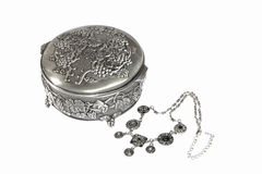 Silver box and jewelries on white Stock Image