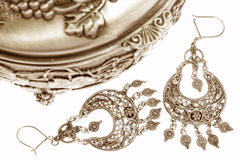 Silver box and jewelries on white Royalty Free Stock Photography