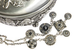 Silver box and jewelries on white Stock Images