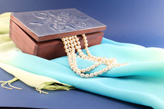 Silver box and pearl necklace Stock Photos