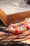 Silver box and red necklace closeup Royalty Free Stock Photo