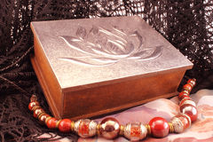 Silver box and red necklace Royalty Free Stock Photo