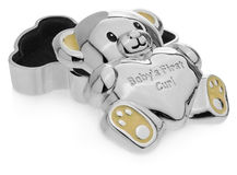 Silver box in the shape of a teddy bear to the first baby teeth. Royalty Free Stock Photos