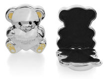 Silver box in the shape of a teddy bear to the first baby teeth. Royalty Free Stock Images