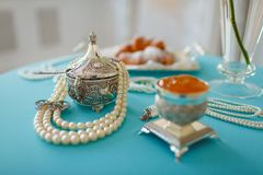 Silver boxes and pearl beads on the table royalty free stock photos