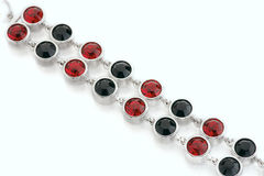 Silver bracelet. With red and black stones Royalty Free Stock Photos