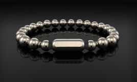 Silver bracelet  on black Royalty Free Stock Photos