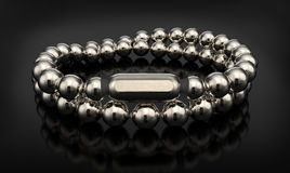 Silver bracelet  on black Royalty Free Stock Images