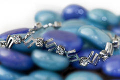 Silver bracelet on blue stones Stock Photos