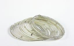 Silver bracelet close up shot. Silver spiral bracelet on white Stock Image