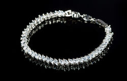 Silver bracelet with diamonds on black background Stock Photos