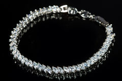 Silver bracelet with diamonds on black background Stock Image