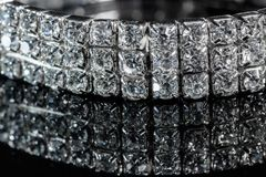 Silver bracelet with diamonds close-up on a black mirror background.  Stock Photography