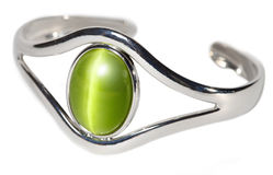 Silver bracelet with green stone. Silver bracelet with a big green stone isolated on white Stock Photography