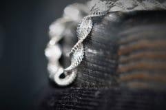 Silver bracelet. In macro view stock image