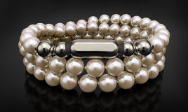 Silver bracelet  with pearls  on black Stock Photos