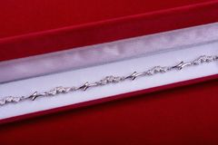 Silver bracelet in red velvet box on red background Royalty Free Stock Photos