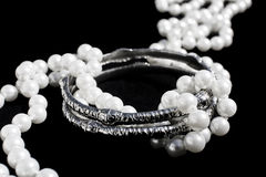 Silver bracelets and pearls Stock Photos