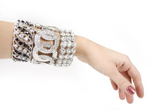 Silver bracelets on woman hand. On a white background stock photos