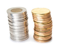 Silver and brass coins Stock Images