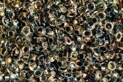 Silver brass eyelet background texture. Close view royalty free stock photography