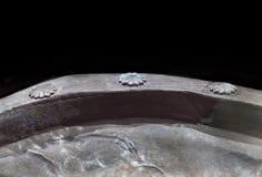 Silver brazier, piece of tartessos hoard of Aliseda, Caceres, Sp. Aliseda, Spain - October 29, 2017: Silver brazier. Rivets rosette detail. Hoard gold of Aliseda stock images