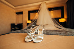 Silver Bride shoes on a bed before ceremony Stock Image