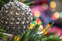 Silver colored eve toy decorations with lights royalty free stock photo