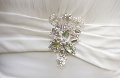 Silver brooch with big rhinestones on white silk dress. Of girl or woman or bride Stock Photos