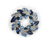 Silver brooch with blue and white gemstones Stock Photos