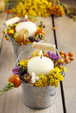 Silver bucket with autumn flowers and other plants. royalty free stock image