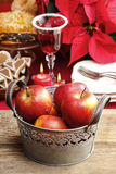 Silver bucket of red christmas apples Royalty Free Stock Images