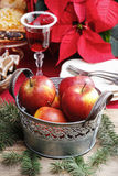 Silver bucket of red christmas apples Stock Photos
