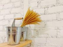 Silver bucket on white wall interior Royalty Free Stock Photo