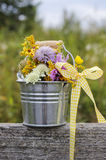 Silver bucket with wild flowers stock images