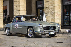 A silver 1955 built Mercedes-Benz on the road Stock Images