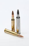 Silver bullet. Two brass rifle round and a silver bullet Royalty Free Stock Photos