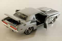 Silver bullet. Picture of a miniature replica of a toy car Stock Photography