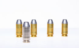 Silver Bullet. A silver bullet with a group of gold bullets stock images