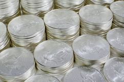 Silver Bullion. Stacks of one ounce American Eagle silver coins royalty free stock photos