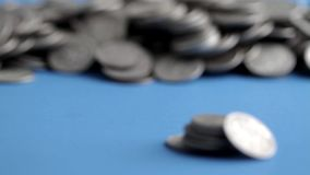 Silver bullion dimes on blue tabletop stock footage