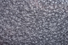 Silver bultad metallbakgrund, abstrakt metallisk textur, ark av metallyttersida som målas med hammaremålarfärg Royaltyfria Bilder