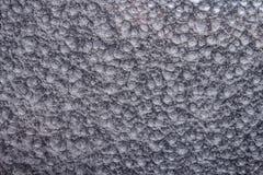 Silver bultad metallbakgrund, abstrakt metallisk textur, ark av metallyttersida som målas med hammaremålarfärg Arkivfoton