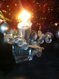 Silver burning candle in candlestick. Silver burning candle in a candlestick, new year`s toys, festive evening royalty free stock image